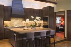 Decorations, Cool Kitchen Remodeling Ideas With Dark Wood Kitchen Island Table With Laminate Wood Countertop Wooden Bar Stools With Back Black Kitchen Hood Stone Backsplash L Shaped Dark Wood Kitchen Cabinet With Built In Double Oven: Best Tips And Advice of Kitchen Remodeling for Your Home