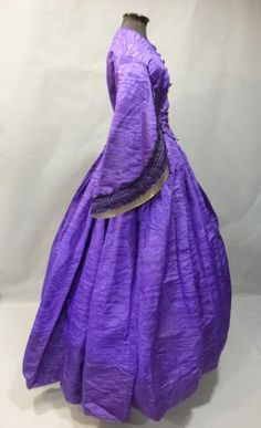 Dress, ca. 1860. Violet ottoman silk moiré. Widely flared pagoda sleeves lined with white satin & black du Puy lace.