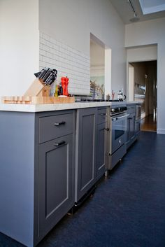 Dark gray Marmoleum floors look good against the hardwood and cabinets.