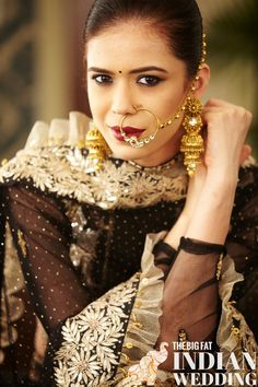 the ruffles, the jewelry, the dark red lipstick, the nosering, the jhumka earrings - what is not to love about this Indian lengha? | Designer Rina Dhaka for India Couture Week