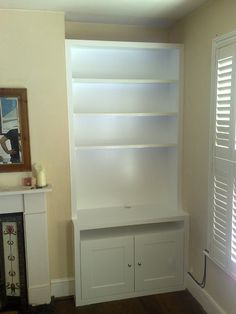alcove with tv cupboard