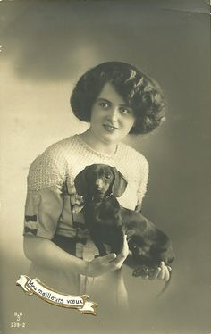 Vintage photo of a lady with a dachshund.