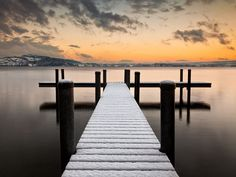 Sitting on a dock overlooking the water is the most serene and breathtaking way to relax.
