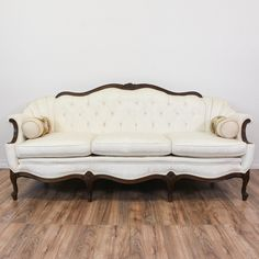 This french victorian inspired sofa is upholstered in a durable shiny moire fabric with a shiny white thread. This loveseat sofa is in great condition with a curved camel back, tufted details and carved dark cherry wood trim. Elegant sofa perfect for lounging in style! #victorian #sofas #sofaorcouch #sandiegovintage #vintagefurniture