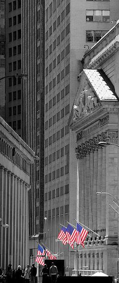 New York Stock Exchange on Wall St. with highlighted American Flags. New York City   NYC.  By Andrew Fare