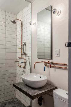 This innovative Brooklyn apartment renovation features funky but sensible repurposed materials while fully optimizing the unit& 675 square feet. Copper Bathroom, Bathroom Plumbing, Basement Bathroom, Modern Bathroom, Industrial Bathroom Design, Plumbing Pipe, Bathroom Colors, Bathroom Sets, Small Bathroom