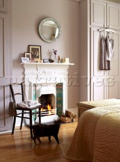 Open log fire burning in the Victorian tiled fireplace in the bedroom Walls and cupboards are painte Dream Bedroom, Home Bedroom, Bedroom Wall, Girls Bedroom, Master Bedroom, Bedroom Decor, Bedrooms, Bedroom Ideas, Bedroom Fireplace