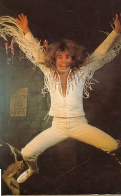 Ozzy Osbourne in his iconic fringe sleeved shirt!
