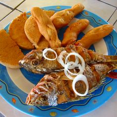 The most popular place to have Escovitch Fish and festival is Hellshire Beach in St. Catherine (near Kingston).  Escovitch fish is seasoned, fried, and marinated in tasty vinegar.