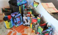 She gestures to the myriad of products lining the walls, including sturdy purses made of car inner tubes, potato chip bag wallets, belts made from bicycle tires, recycled wine bottle glasses, and even laptop slips woven from cement bags.