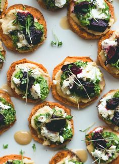 Sweet Potato Rounds with Hummus, Arugula Basil Pesto, Goat Cheese, Roasted Beets, Sprouts, and a drizzle of honey. Can be made vegan too! Gluten-free.