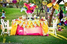 Adorable centerpiece for a bright tea party.