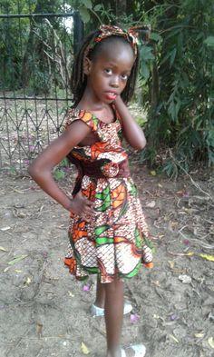 A colourful Kitenge dress with a Rose flower. Ankara love dresses