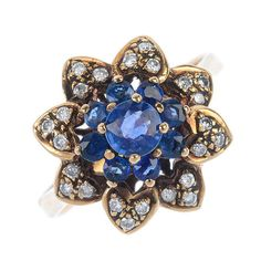 A beautiful sparkly sapphire and diamond floral cluster ring.  Designed as a circular-shape sapphire cluster, to the brilliant-cut diamond petal