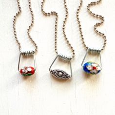 Make these cute pendants in less than a minute with NO TOOLS! Made from the spring of a clothespin. Check out the crazy simple tutorial.
