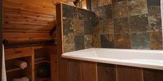 Spacious bathroom with soaker tub to unwind in. Luxury Cabin, Soaker Tub, Bathroom, Home, Sunken Tub, Washroom, Full Bath, Ad Home, Homes