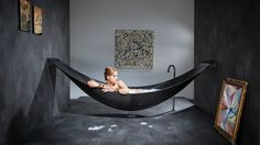 I'll take one in white or pink, thank you :-) Hammock Bathtub: Another Amenities for Relaxing Bathroom Design : Cool Modern Bathtub Design That Suspended From The Walls Ideas Hammock Bathtub, Room Hammock, Modern Bathtub, Modern Bathroom, Funky Bathroom, Black Bathtub, Deep Bathtub, Minimal Bathroom, Bathroom Black