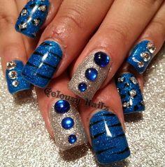 Blue and silver animal print nail design