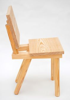 This wooden chair by designers Markus Bergström and Joe Nunn of Glass Hill for Phillips de Pury is on show at the Saatchi Gallery in London. Chunky dowels form legs and support the backrest, and are inserted in two batons supporting the seat. Made of pine, the chair is on show alongside work by Max More