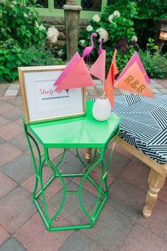 "Cute green table with a ""share the love"" wedding hashtag and custom party pendants at Willowdale Estate for a colorful summer reception!"