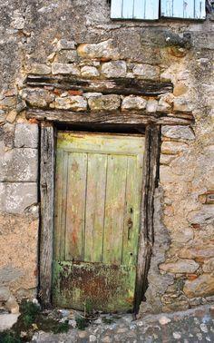 Weather-worn ancient door in Cordes-sur-Ciel, France. DOOR