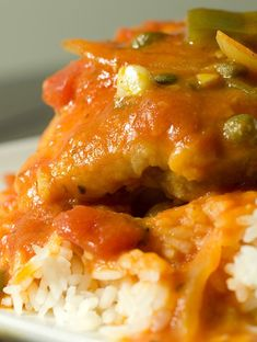 Pan fried chicken thighs simmered in a rich tomato sauce with flavors of white wine, capers and oregano.