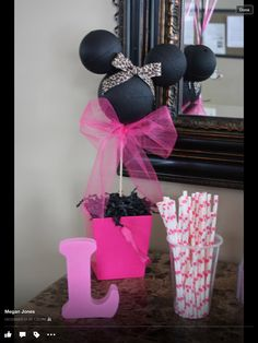 Minnie Mouse party... Make Minnie Mouse heads from painted styrofoam balls