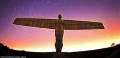 For an angel: Phil Daintith captures swirling stars over the Angel of the North in Gateshead, Tyne and Wear