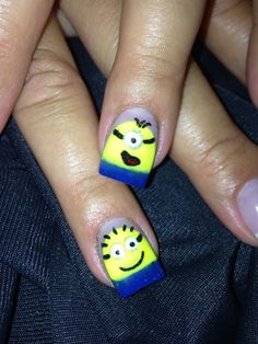Minion Nail Art, I would have used a small google eye! check out www.ThePolishObsessed.com for more nail art ideas.