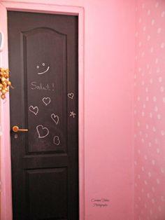 Pink pantry, black door.