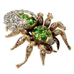 A Demantoid Garnet and Diamond Spider Brooch.