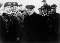 Prime Minister Sir Winston Churchill visits the crew at the HMS George V, one of Britain's most formidable battleships during World War II. Carrying the flag of Admiral John Tovey, the HMS King George V played a crucial part in the sinking of the Bismarck.
