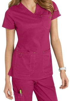 This sturdy v-neck top has great details such as roomy pockets, contrast stitching, elastic bungee, contrast binding and v-loop! Med Couture Niki V-neck Solid Scrub Tops V-neck Two front patch pockets and chest pocket Center back length for a Small 26 Medical Uniforms, Costume, Scrub Tops, V Neck Tops, Scrubs, Fashion Beauty, Neckline, Rompers, Cotton