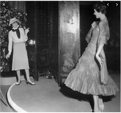 """Here is Gabrielle (""""Coco"""") Chanel in 1938 working with a model. I remember my teachers in my girls' school during the 1970s wearing such outfits of blouse and tailored skirt, although their tweed skirts were not nearly as well-tailored as Chanel's. Nor did they wear two-tone sandals, a scarf a hat when teaching..."""