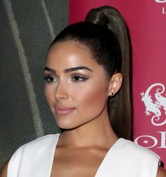 Olivia Culpo showing off her Ariana Grande-inspired high ponytail