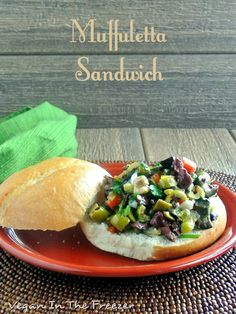 Muffuletta Sandwich is loaded with wonderful ingredients and flavors. The main one being all kind of olives. Just waiting for you to take a big bite.