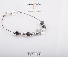 Γυναικείο βραχιόλι με κρύσταλλα και ασημί σταυρό. #handmade #jewelry #fashion