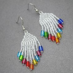 Beautiful rainbow goodness! Just looking at these unique earrings makes me smile from ear to ear! Crystal white seed beads with a colorful glass bead at each bo
