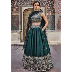 Beautifully embroidered with our signature craft Gota Patti, the Vatsala Lehenga sparkles with every step you take. The emerald green silk lehenga is perfect for any royal occasion. Style Tip: Pair this beautiful lehenga with jadau chand b Indian Lehenga, Green Lehenga, Raw Silk Lehenga, Indian Wedding Lehenga, Royal Blue Lehenga, Wedding Lehanga, Party Wear Lehenga, Bridal Lehenga Choli, Lehnga Dress