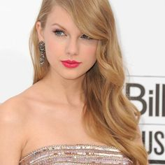 I love the side swept hair on her!!