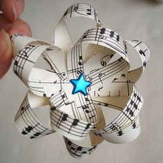 Fun music bow easy to do with old or damaged sheet music, know your sweethearts favorite song? get the sheet music and wrap then bow with it :)