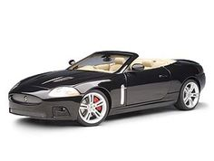 This Jaguar XKR Convertible Diecast Model Car is Midnight Black and features working steering, suspension, wheels and also opening bonnet with engine, boot, doors. It is made by AUTOart and is 1:18 scale (approx. 24cm / 9.4in long).  ...