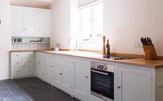 Birch plywood cabinets with hand painted hardwood frames (Farrow and Ball Estate Eggshell, Pale Powder). Kitchen Larder Cupboard, Shaker Style Kitchen Cabinets, White Shaker Kitchen, Shaker Style Kitchens, Old Kitchen, Dining Table In Kitchen, Country Kitchen, Kitchen Furniture, Kitchen Interior