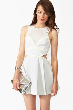 In Dreams Dress: Totally chic ivory dress featuring a quilted cutout waist and sheer mesh detailing. Pleated skirt with side pockets, zip closure at back. Partially lined. Looks perfect paired with a clutch and platform pumps! By Three Floor.
