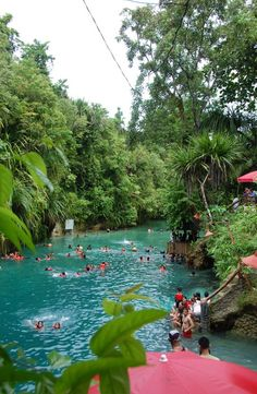Tourists having fun at The Enchanted River in Surigao del Sur, Philippines.