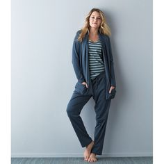 Women's lounge sweater crafted of soft and cozy Pima cotton interlock from Peru. Relaxed fit, draped open neckline and loose, draped pockets.