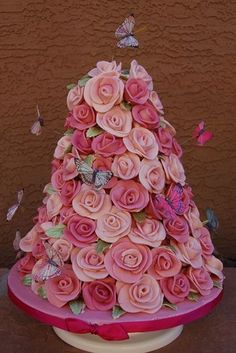 Rose tower cake By modthyrth on CakeCentral.com