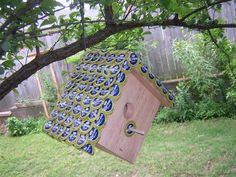 Bird house with bottle cap roof