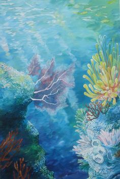 Colorful underwater reef scene with sun rays shining through the water. Hard and soft corals and sea fans are seen through crystal clear