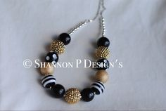 A personal favorite from my Etsy shop https://www.etsy.com/listing/247556381/gold-and-black-chunky-beaded-necklace
